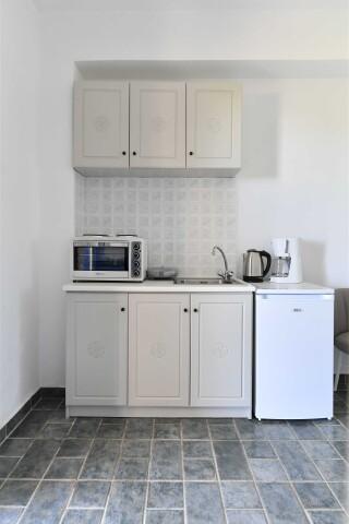 room eight agrabeli apartments kitchen