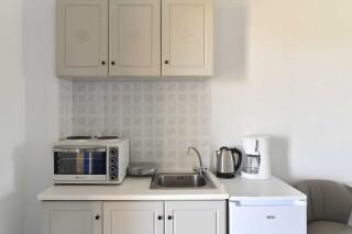 room eight agrabeli apartments kitchenette